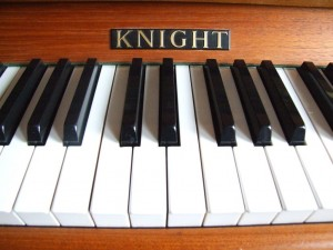 keys and name board of a knight piano
