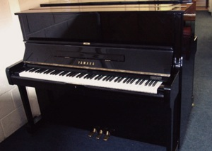 black upright piano by yamaha pianos