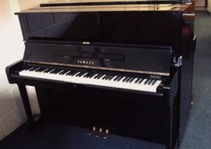 black upright piano by yamaha pianos