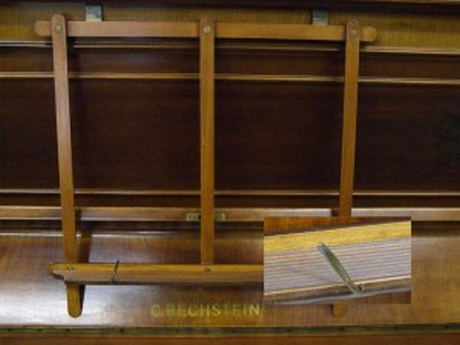 Bechstein bookholder. Not very easy to fit on polyester pianos