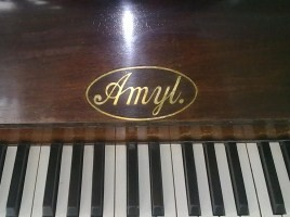 Upright piano by Amyl pianos