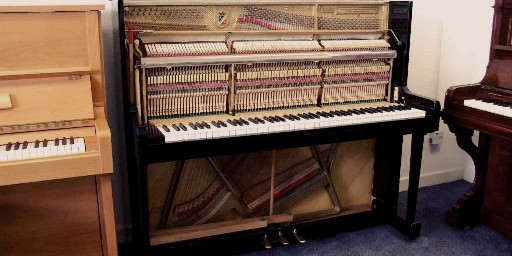petrol upright piano with a practice pedal