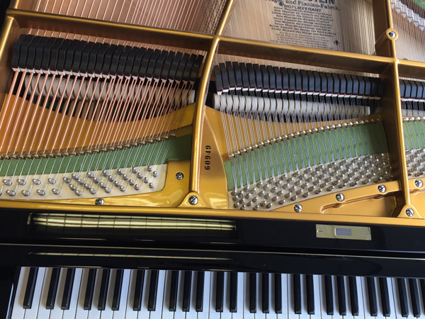 Why we love to restore Yamaha grand and upright pianos.