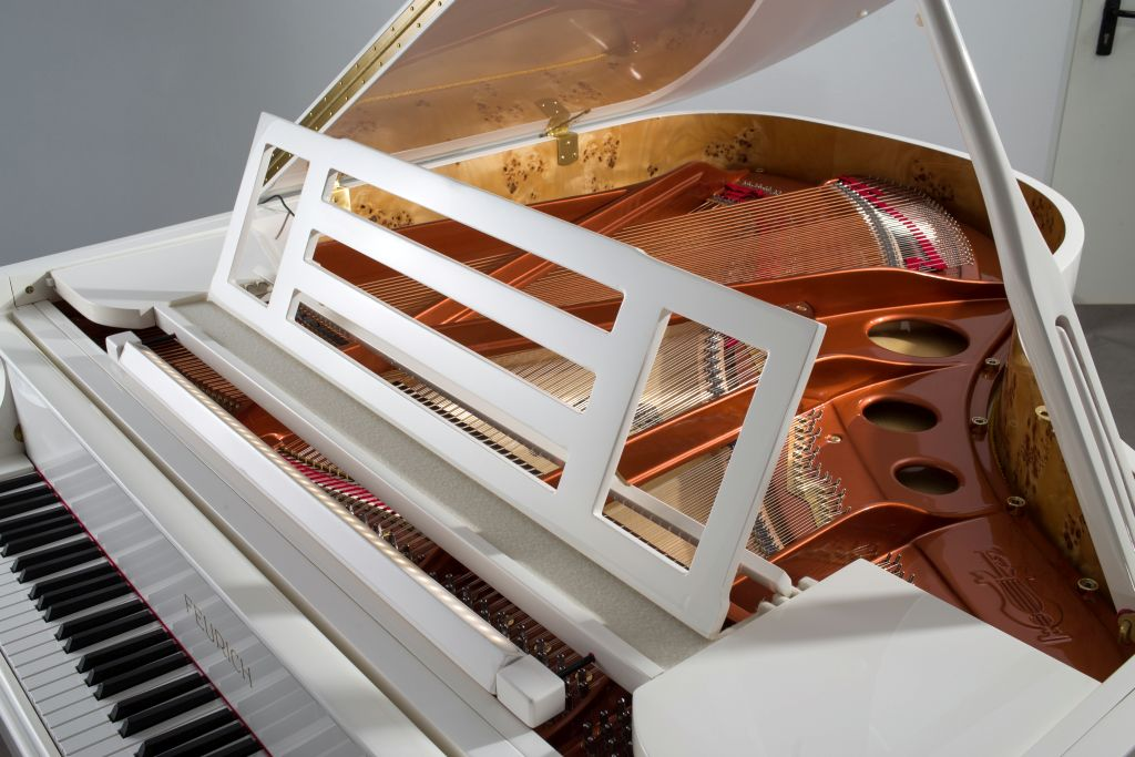 white feurich 179 grand piano
