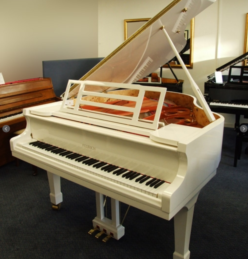 white feurich 161 grand piano