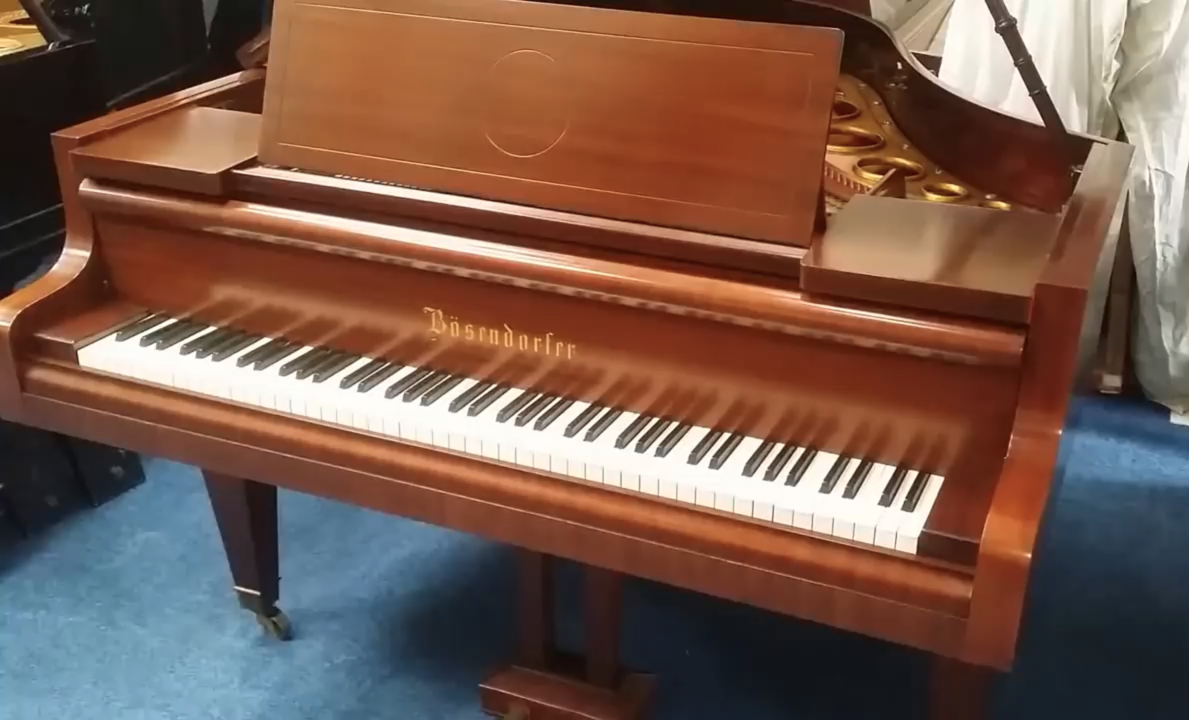 Bosendorfer grand piano in mahogany case