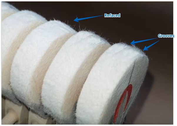 Photo showing wear on hammers in the bass of a grand piano