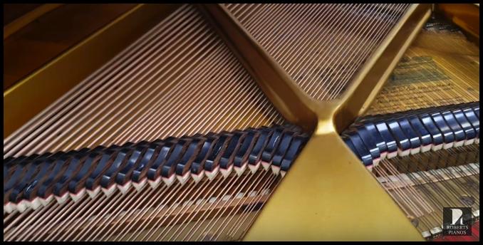 The semi-circular shape allows for longer bass strings