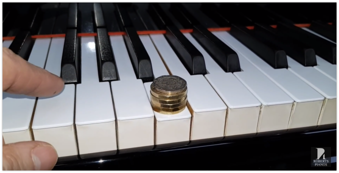 Key weight measuring on a Yamaha G2 grand piano for sale